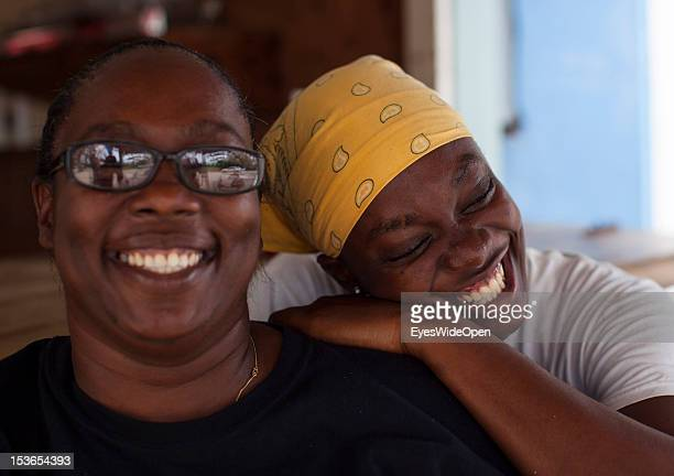 Portrait of a local bahamian woman and mother with her daughter at their foodstall at New Bight Beach on June 15 2012 in Cat Island The Bahamas