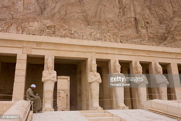 Portrait of a local guide near the colossi of Pharaohs at the otherwise deserted ancient Egyptian Temple of Hatshepsut near the Valley of the Kings...