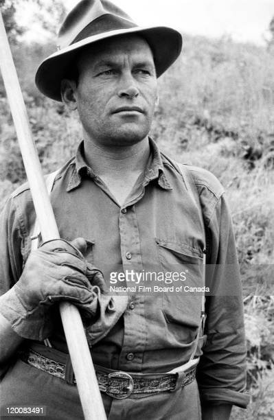 Portrait of a log driver standing proudly with his pike pole on his shoulder Quebec Canada 1956 Photo taken during the National Film Board of...