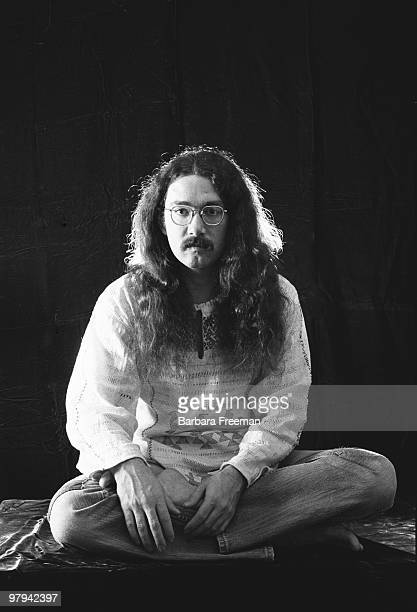 Portrait of a longhaired man with moustache and eyeglasses in typical 70s fashion sitting crosslegged Pittsburgh PA 1975
