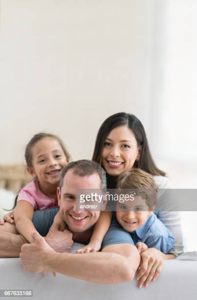 Portrait of a loving Latin American family at home