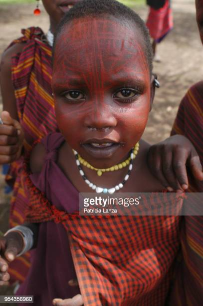 Portrait of a Maasai girl in traditional attire and with red ochre facepaint Tanzania January 6 2007