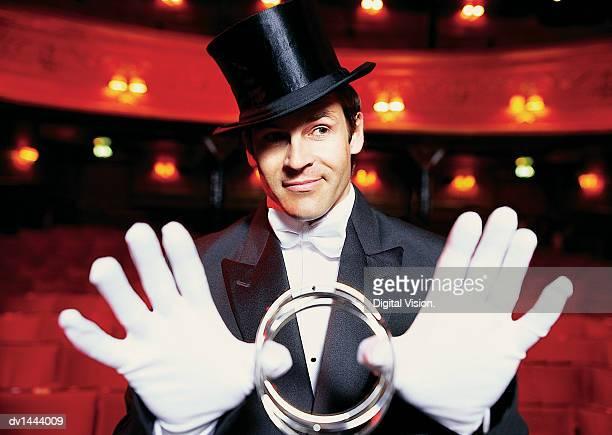 Portrait of a Magician Performing a Magic Trick
