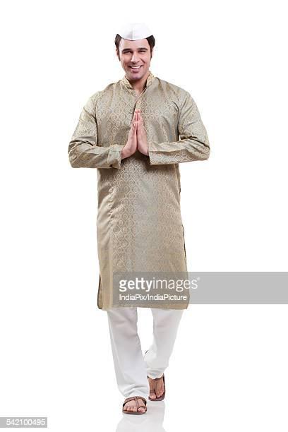 portrait of a maharashtrian man greeting - kurta stock pictures, royalty-free photos & images