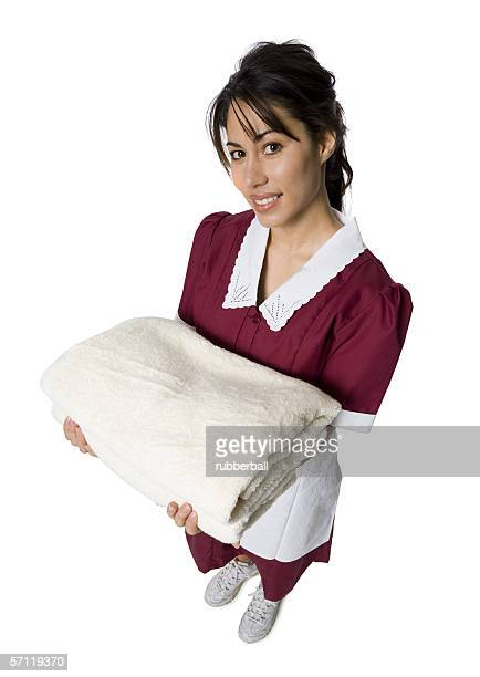 Portrait of a maid holding folded towels