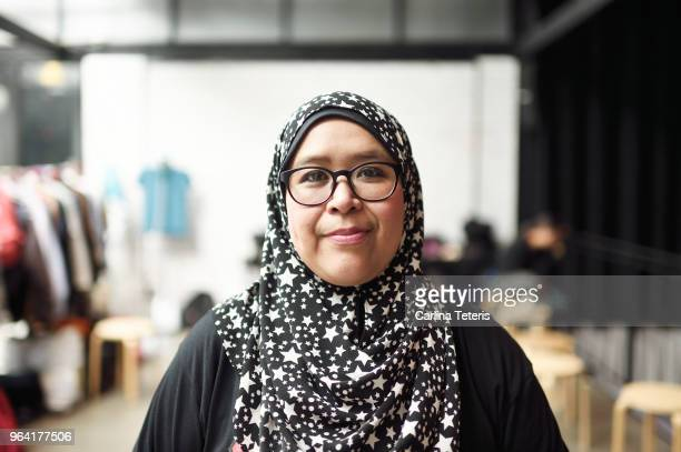 Portrait of a Malay woman in a clothing store