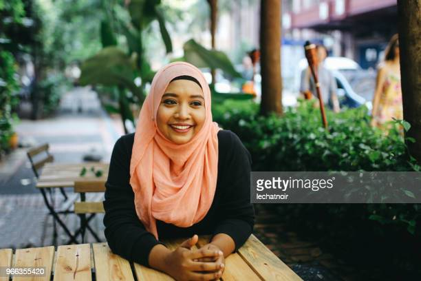 portrait of a malaysian woman on the cafe in kuala lumpur - islam stock pictures, royalty-free photos & images