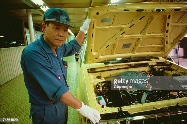 Portrait of a male auto mechanic repairing a car, Zama, Kanagawa Prefecture, Japan