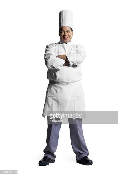 Portrait of a male chef standing with his arms folded