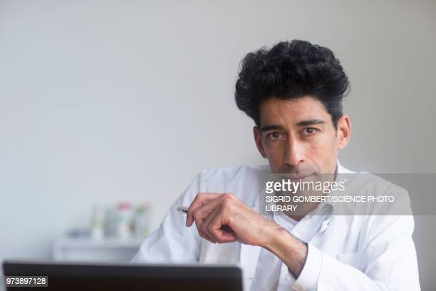 portrait of a male doctor - sigrid gombert stock pictures, royalty-free photos & images