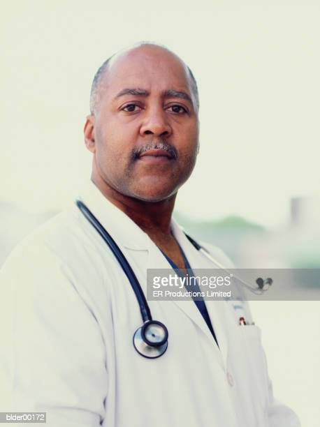 portrait of a male doctor with a stethoscope around his neck - part of a series stock pictures, royalty-free photos & images