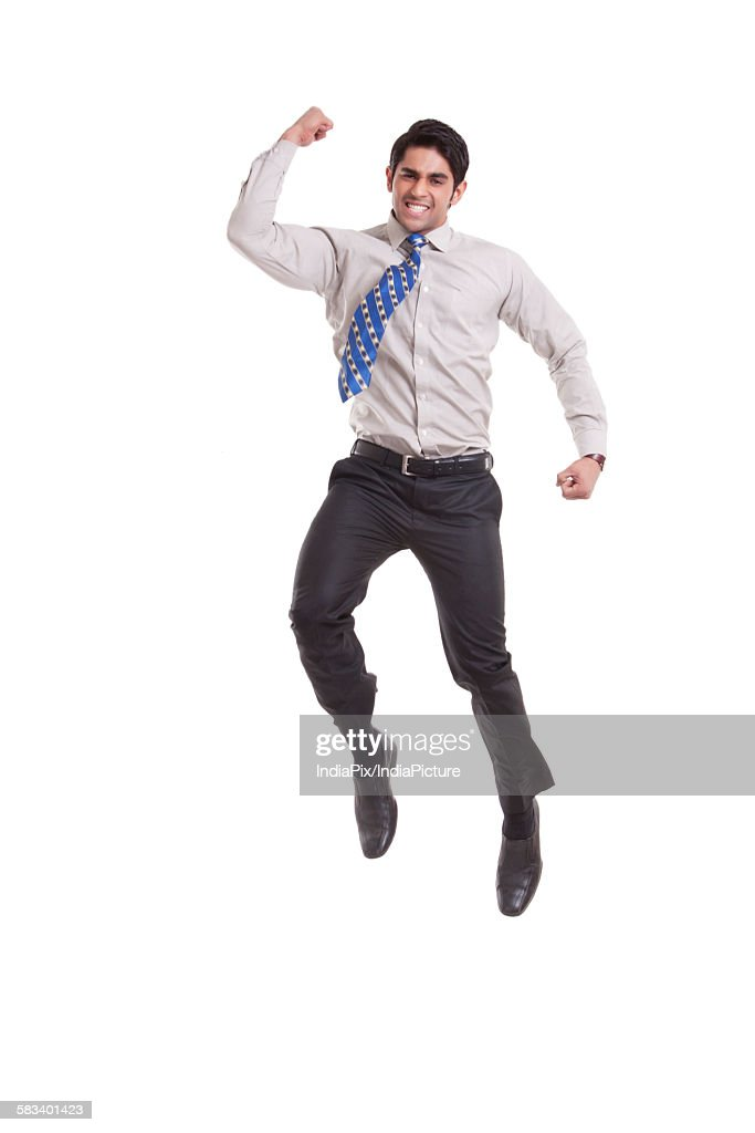 Portrait of a male executive jumping in the air : Stock Photo