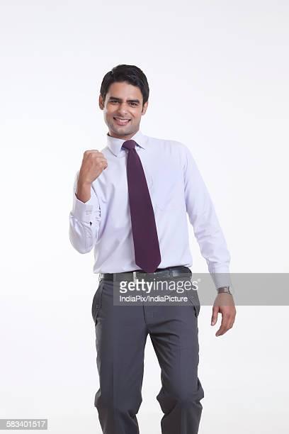 Portrait of a male executive rejoicing