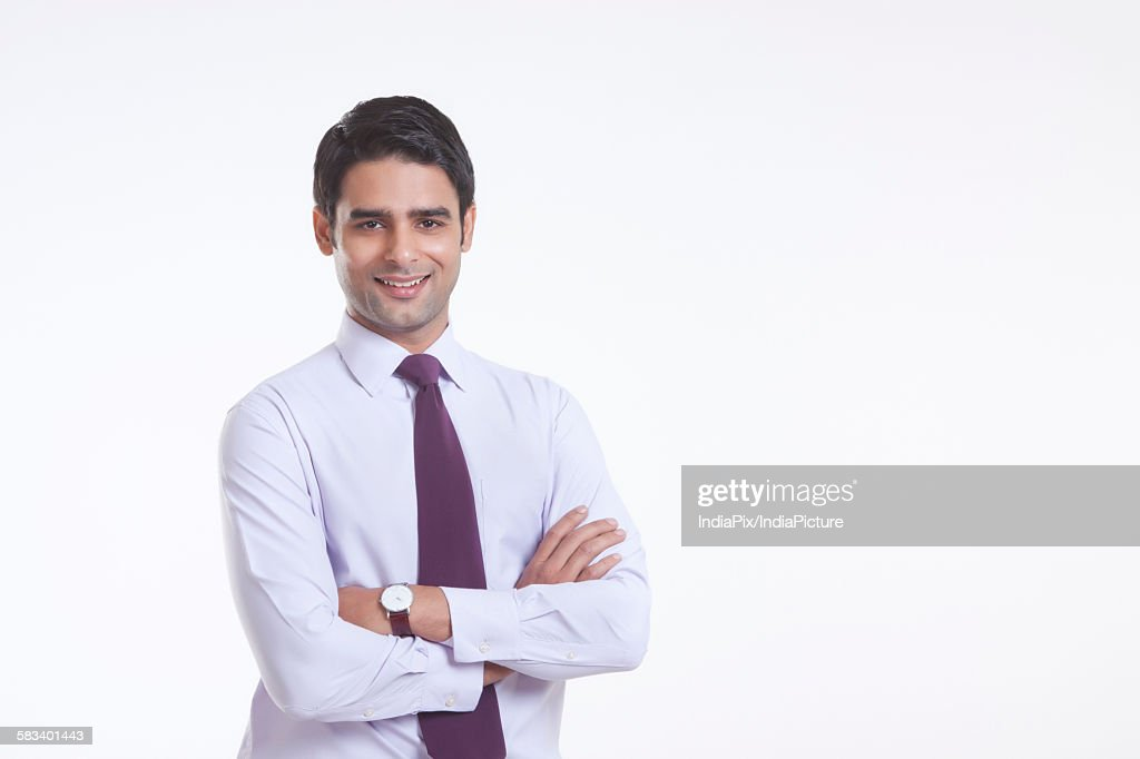 Portrait of a male executive smiling : Stock Photo