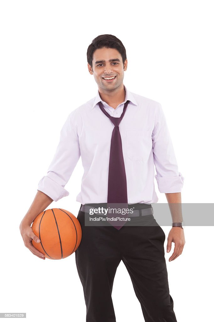 Portrait of a male executive with a basketball : Stock Photo