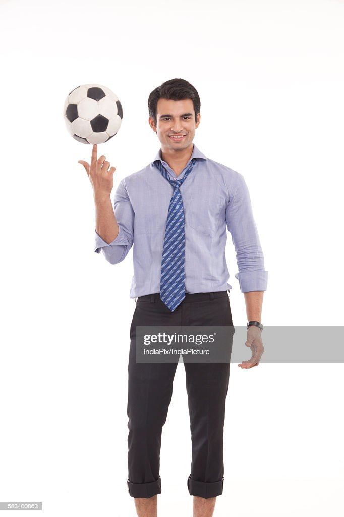 Portrait of a male executive with a football : Stock Photo