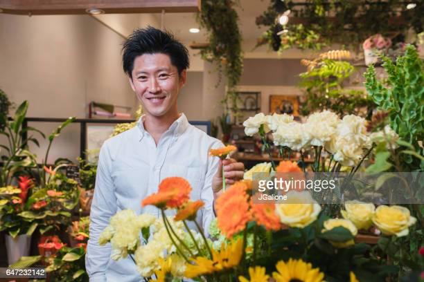 雄花のショッピングの肖像画 - 百貨店 ストックフォトと画像
