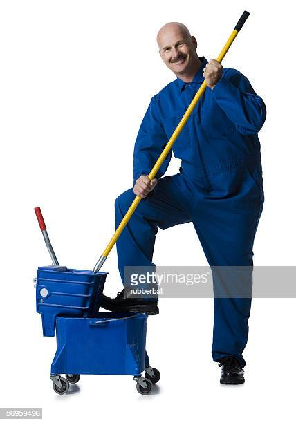 Portrait of a male janitor holding a mop