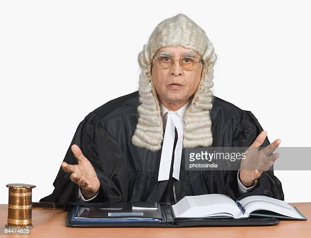 portrait of a male judge giving judgment - headwear stock pictures, royalty-free photos & images