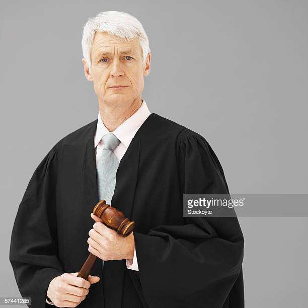 Portrait of a male judge, holding a gavel