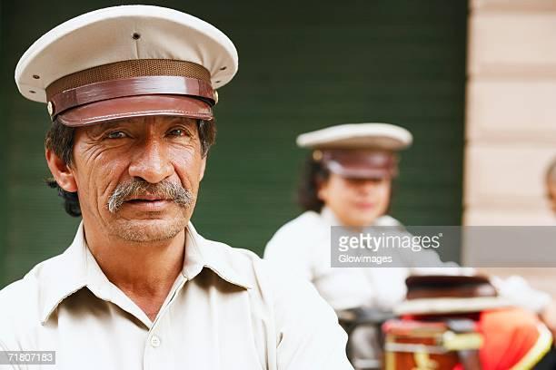 portrait of a male musician - uniform cap stock pictures, royalty-free photos & images