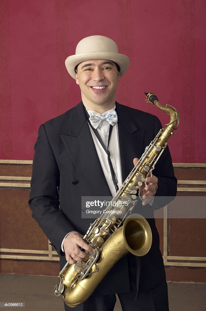 Portrait of a Male Saxophonist in a Suit and a Porkpie Hat : Stock Photo