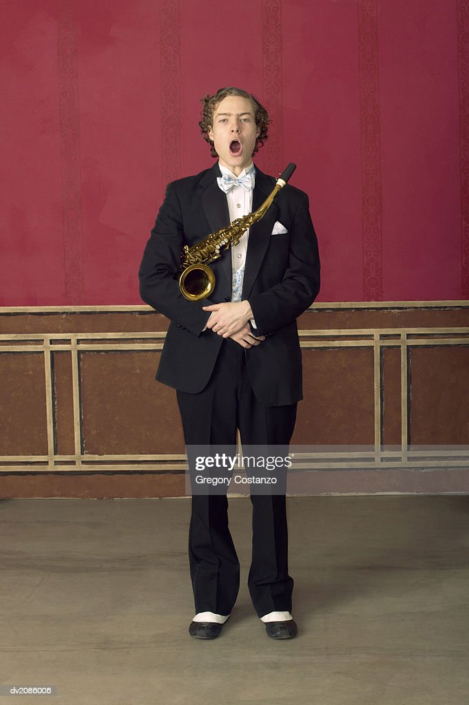 Portrait of a Male Saxophonist in an Old Fashioned Suit, Singing : Stock Photo