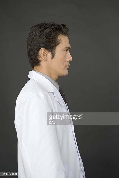Portrait of a male scientist, side view, black background
