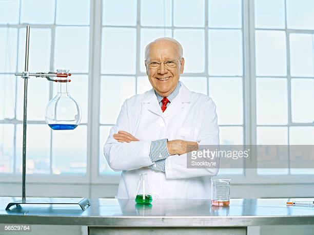 portrait of a male scientist standing with his arms crossed