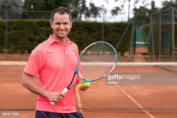 portrait of a male tennis player - racquet sport stock photos and pictures