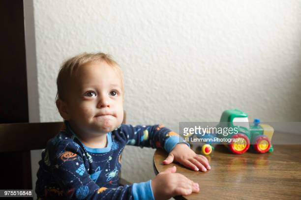 portrait of a male toddler experiencing hand mouth and foot disease - blister stock pictures, royalty-free photos & images