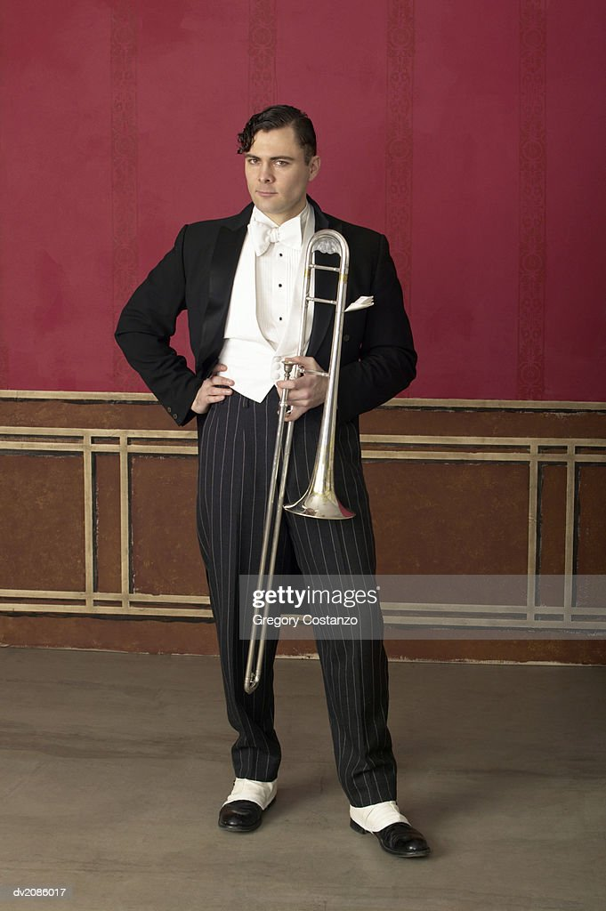Portrait of a Male Trombonist in a 1940s Style Suit : Stock Photo
