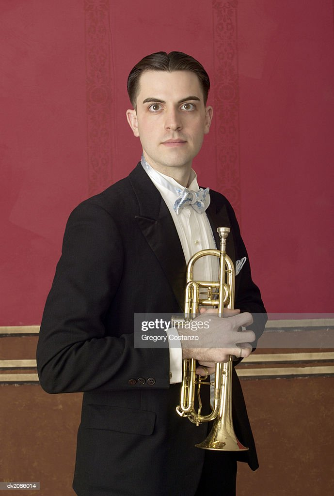 Portrait of a Male Trumpet Player in a Suit : Stock Photo