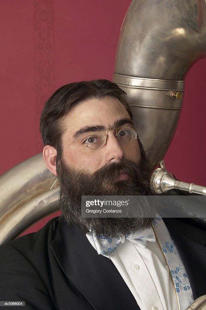 Portrait of a Male Tuba Player in a Suit and Bow Tie : Stock Photo