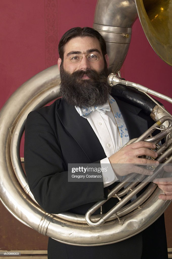 Portrait of a Male Tuba Player in an Old-Fashioned Suit : Stock Photo