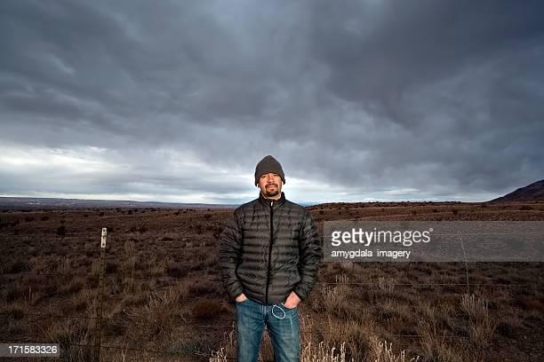 portrait of a man and desert landscape