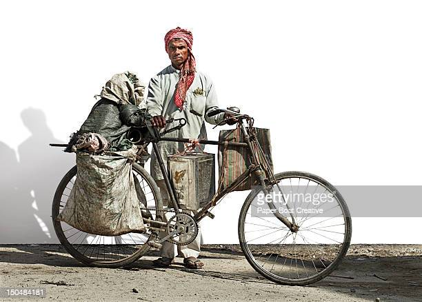 portrait of a man carrying recycled objects