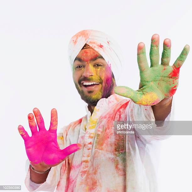 Portrait of a man dancing on Holi