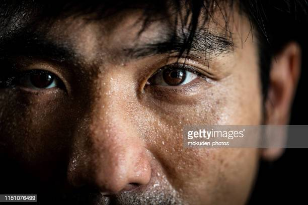 portrait of a man doing sports training - determination stock pictures, royalty-free photos & images
