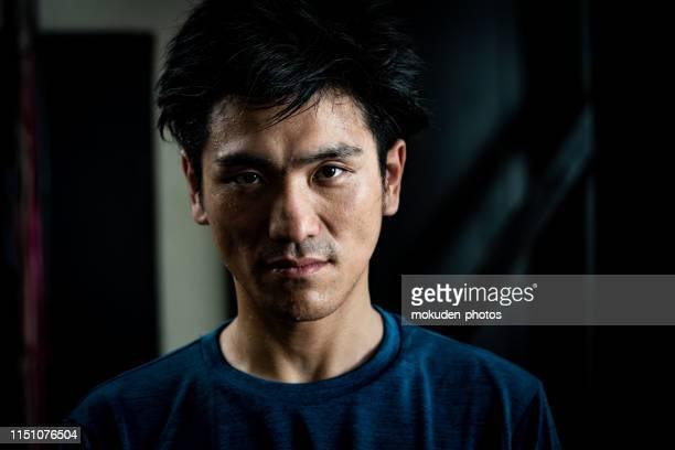 スポーツトレーニングをしている男の肖像 - sportsperson ストックフォトと画像
