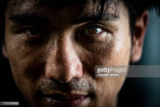 portrait of a man doing sports training - one mid adult man only stock pictures, royalty-free photos & images