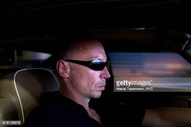 Portrait of a man driving a car.