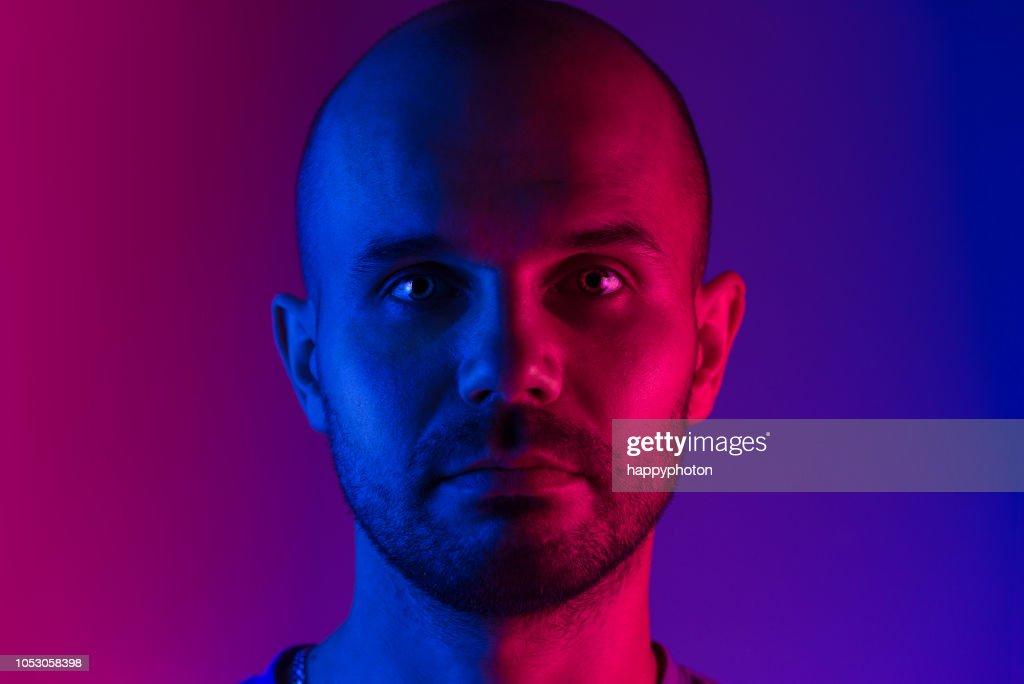 Portrait of a man. Dual tone lighting theme : Stock Photo