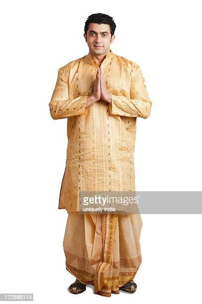 portrait of a man greeting - kurta stock pictures, royalty-free photos & images