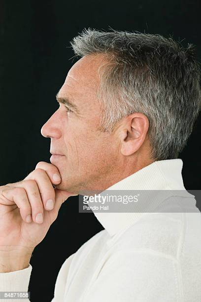 Portrait of a man, hand on chin, side view
