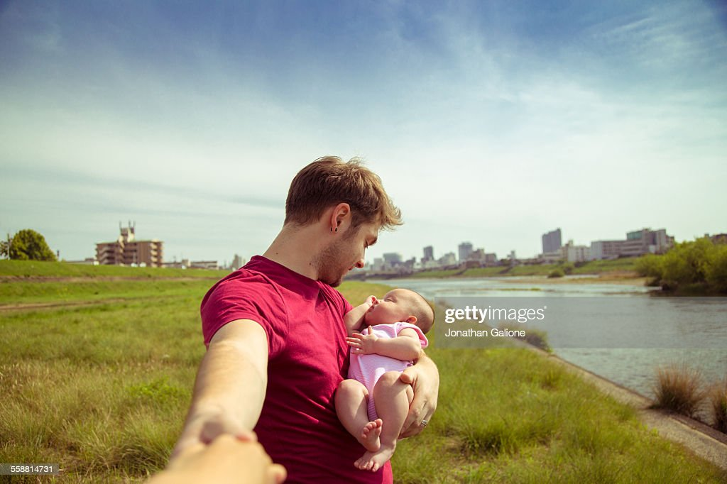 Portrait of a man holding a baby girl : Stock Photo