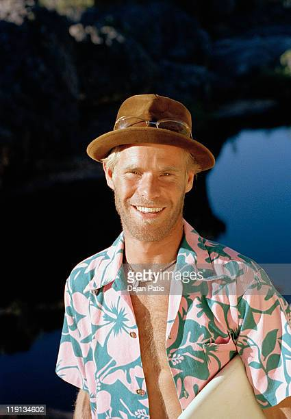 portrait of a man holding a surfboard - fully unbuttoned stock pictures, royalty-free photos & images