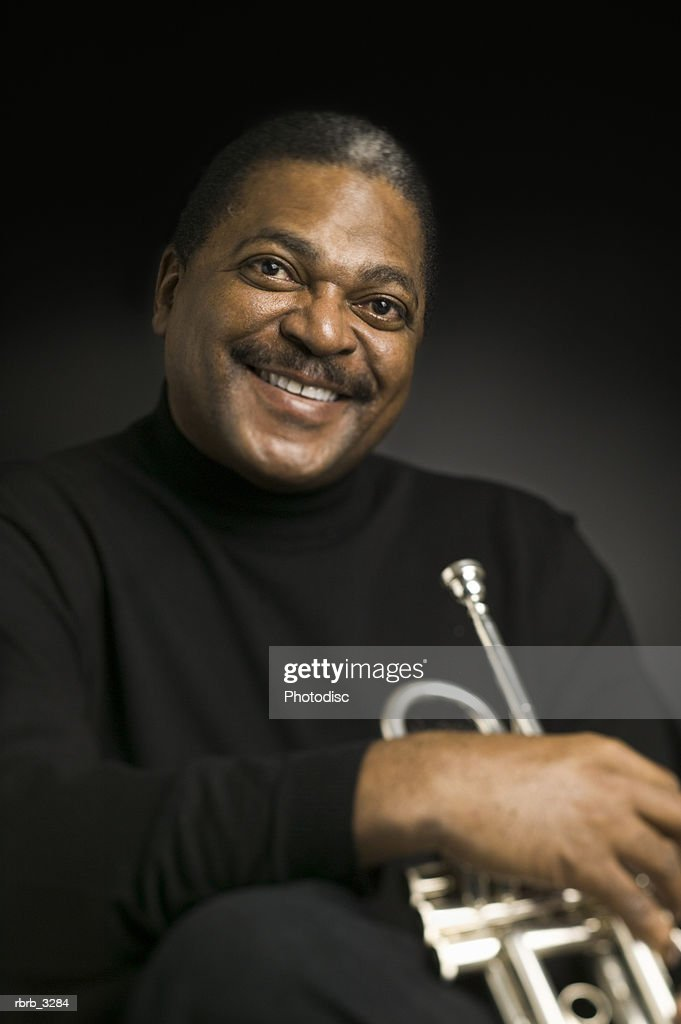Portrait of a man holding a trumpet : Foto de stock