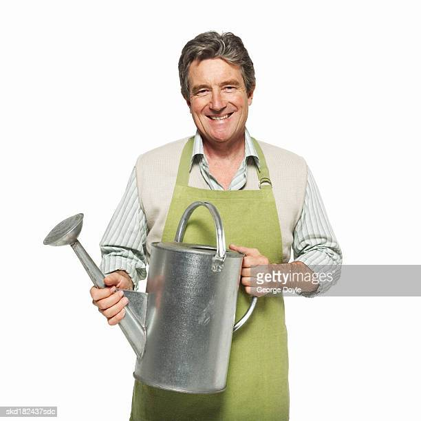 portrait of a man holding a watering can