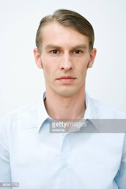Portrait of a man in a blue shirt